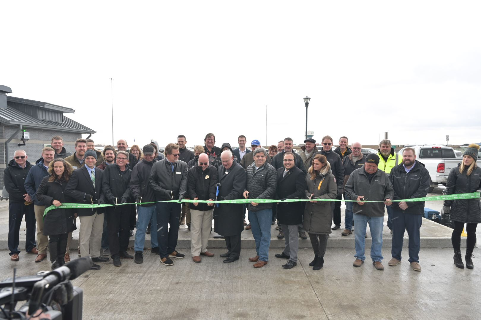 Officials cut the ribbon on the grand opening of the Sheyenne Street construction